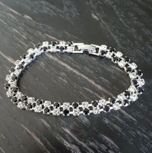 Silver bracelet with black stones